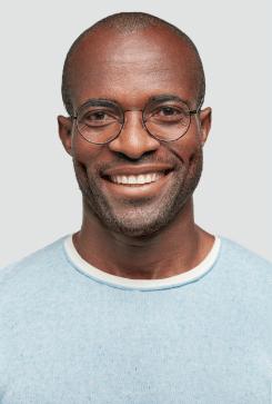 Bald Man with Light Blue Shirt Smiling